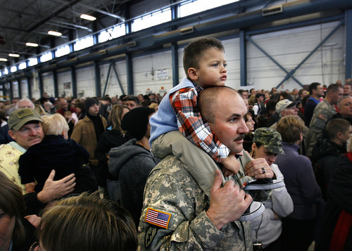 Scott Sommerdorf     The Salt Lake Tribune              Trent Buckalew holds his grandson Tanner, 3, as Buckalew, along with 259 other soldiers of the Utah Army National Guard's First Battalion, 211th Aviation prepare to leave on the first leg of their 12-month deployment to Afghanistan, Monday January 16, 2012.