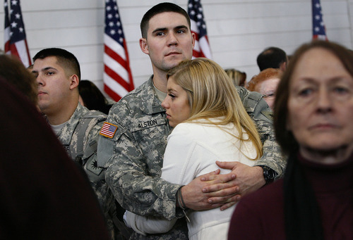 Scott Sommerdorf     The Salt Lake Tribune              Stephen Alston holds his sweetheart Ali Azemar as he and other soldiers of the Utah Army National Guard's First Battalion, 211th Aviation prepare to leave on the first leg of their 12-month deployment to Afghanistan, Monday January 16, 2012.