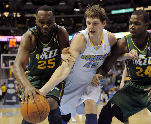 Utah Jazz center Al Jefferson (25), Denver Nuggets center Timofey Mozgov (25) from Russia and Paul Millsap (24) go after a loose ball during the first quarter of an NBA basketball game, Sunday, Jan. 15, 2012, in Denver. (AP Photo/Jack Dempsey)