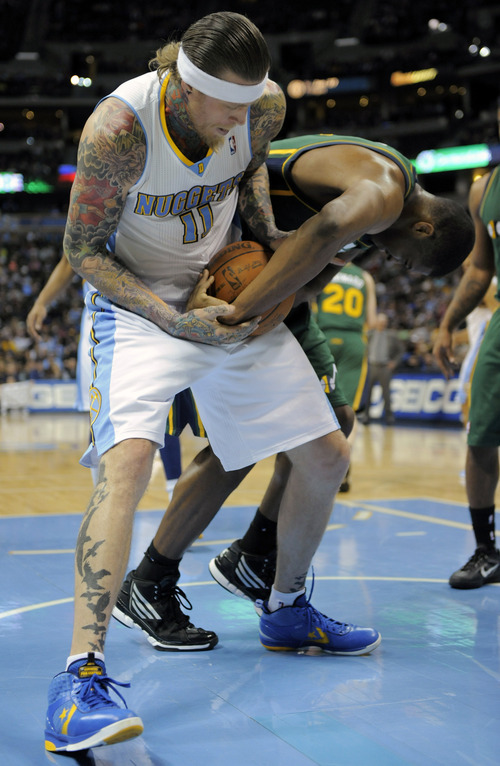 Jack Dempsey  |  The Associated Press Denver Nuggets center Chris Andersen (11) and Utah Jazz forward Derrick Favors (15) fight for possession during the second quarter of an NBA basketball game Sunday in Denver. The Jazz won, 106-96.