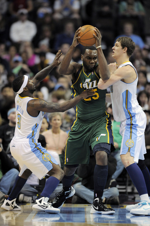 Jack Dempsey  |  The Associated Press Utah Jazz center Al Jefferson (25) is pressured by Denver Nuggets guard Ty Lawson (3) and center Timofey Mozgov (25) from Russia during the first quarter of an NBA basketball game Sunday in Denver. The Jazz won, 106-96.