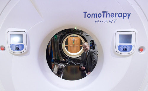 Rick Egan  | The Salt Lake Tribune  Thomas Rockwell Mackie poses inside the TomoTherapy machine he invented during an open house at St. Mark's Hospital to showcase new image-guided radiation therapy technology.