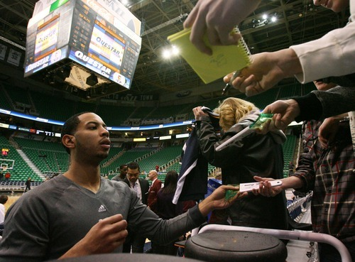 Steve Griffin  |  The Salt Lake Tribune   Utah's Devin Harris signs autographs after his pre game warm-up before the Jazz versus Clippers game at EnergySolutions Arean in Salt Lake City, Utah  Tuesday, January 17, 2012.