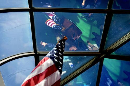 Republican presidential candidate, former Pennsylvania Sen. Rick Santorum is reflected in a glass ceiling of a sunroom as he speaks during a campaign stop at the Beacon Drive-In restaurant, Wednesday, Jan. 18, 2012, in Spartanburg, S.C. (AP Photo/David Goldman)