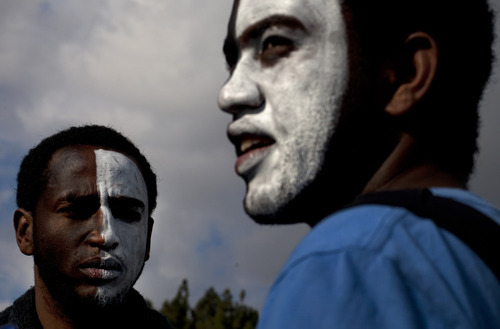 Two Israeli Ethiopian youths have their faces painted, as they take part in a demonstration against racism and discrimination in Jerusalem, Wednesday, Jan. 18, 2012. Thousands of young Ethiopian immigrants and other supporters gathered on Wednesday outside the Israeli parliament, to protest what they say is racism directed at them. (AP Photo/Sebastian Scheiner)