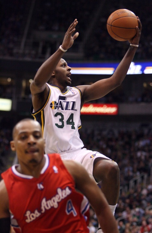 Steve Griffin  |  The Salt Lake Tribune   Utah's C.J. Miles glides to the basket for two points during first half action of the Utah Jazz versus Los Angeles Clippers game at EnergySolutions Arean in Salt Lake City, Utah  Tuesday, January 17, 2012.