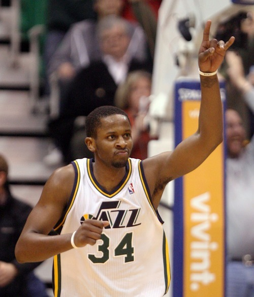 Steve Griffin  |  The Salt Lake Tribune   Utah's C.J. Miles holds two fingers up after dunking the ball during second half action of the Utah Jazz versus Los Angeles Clippers game at EnergySolutions Arean in Salt Lake City, Utah  Tuesday, January 17, 2012.