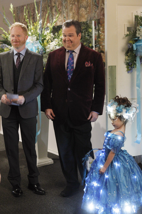 In this image released by ABC, from left, Jesse Tyler Ferguson portraying Mitchell Pritchett, and Eric Stonestreet portraying Cameron Tucker are shown with Aubrey Anderson-Emmons, who plays their adopted daughter Lily in a scene from