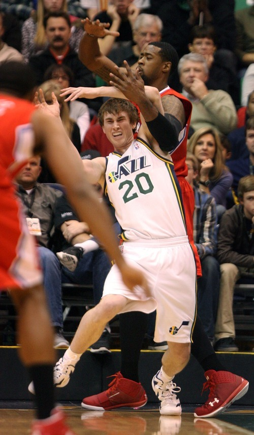 Steve Griffin  |  The Salt Lake Tribune   Utah's Gordon Hayward is fouled by Deandre Jordan of the Clippers during first half action of the Utah Jazz versus Los Angeles Clippers game at EnergySolutions Arean in Salt Lake City, Utah  Tuesday, January 17, 2012.