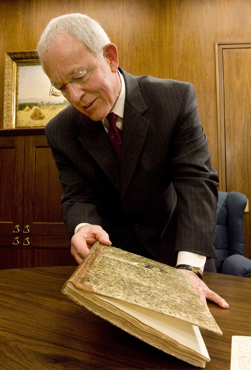 In his office in the LDS Church Office Building in Salt Lake City, Elder Marlin Jensen holds a journal that contains dictated and handwritten entries from Joseph Smith from 1835 and 1836. The journal is part of the LDS Church's Joseph Smith Papers Project. Jensen has been replaced as the church's historian. Monday, February 25, 2008.  Steve Griffin/The Salt Lake Tribune 2/20/08