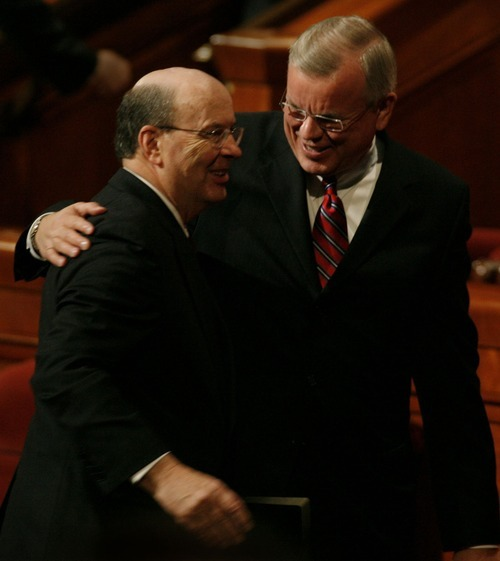 Steven E. Snow, the LDS Church's new historian, puts his arm around Quentin L. Cook after the morning session of General Conference in Salt Lake City in October 2007.   Rick Egan/The Salt Lake Tribune  10/06/2007