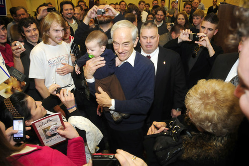 Ron Paul took time to hold, 7 months old, Brody Grant of Gainesville, Ga., as her mother Anisha Perez looks on. Texas Congressman and presidential candidate Ron Paul held a town hall meeting at the Spartanburg Marriott at Renaissance Park on Tuesday, Jan.17, 2012  in Spartanburg, S.C. (AP Photo/The Spartanburg Herald-Journal, Alex C. Hicks Jr)