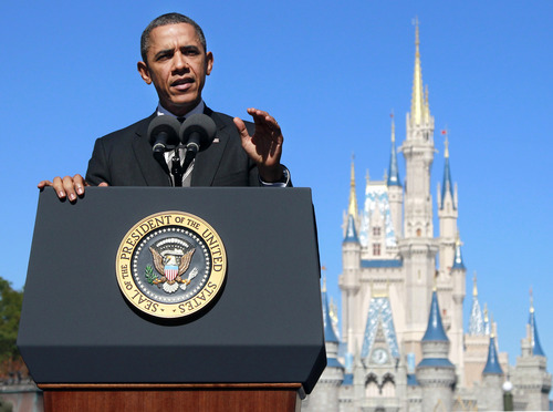 President Barack Obama speaks about tourism and travel, Thursday, Jan. 19, 2012, along Main Street USA at the Walt Disney World Resort in Lake Buena Vista, Fla. (AP Photo/Haraz N. Ghanbari)