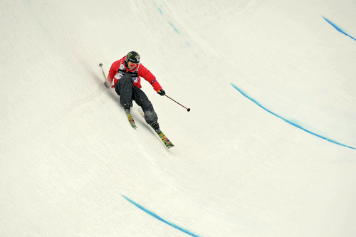 In this Feb. 5, 2011, photo, Sarah Burke, of Canada, takes a fall during the women's halfpipe finals at the freestyle skiing world championships in Park City. Burke died Thursday morning at University Hospital in Salt Lake City, her publicist and hospital officials confirmed. The 29-year-old had been comatose since hitting her head in a fall at the superpipe at Park City Mountain Resort on Jan. 10. (AP Photo/Mark J. Terrill)  Burke died Thursday morning at University Hospital in Salt Lake City, her publicist and hospital officials confirmed. The 29-year-old had been comatose since hitting her head in a fall at the superpipe at Park City Mountain Resort on Jan. 10.