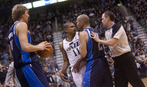 Jeremy Harmon  |  The Salt Lake Tribune  Utah's Earl Watson is pulled away from Dirk Nowitzki by Jason Kidd and referee Matt Boland after he swatted the ball away from Nowitzki as the Jazz host the Mavericks at EnergySolutions Arena Thursday, Jan. 19, 2012 in Salt Lake City. A technical foul was called on Watson.