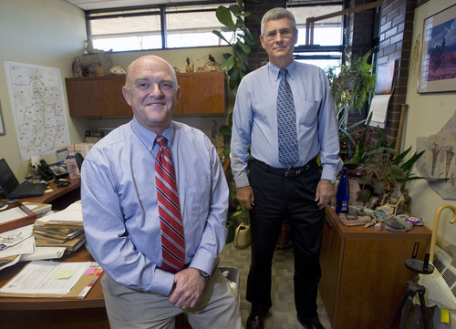 Al Hartmann   |  Tribune file photo  Kent Jones, left, and John Mann, with the Utah Division of Water Rights, are the key deciders in the state on a proposed nuclear power plant in Utah. On Friday, Jones announced his decision to approve the plant. Now approval rests in the hands of the federal Nuclear Regulatory Commission.