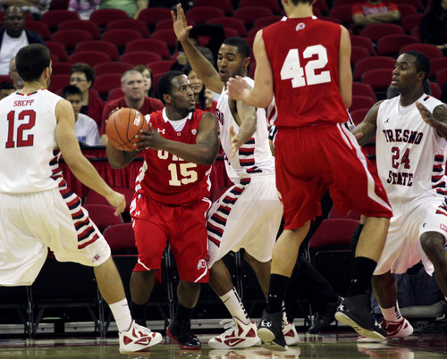 Utah's Josh Watkins, second from left, faces the Fresno State defense in first-period NCAA college basketball game action on Saturday, Dec. 3, 2011, in Fresno, Calif. Fresno State defeated Utah 82-52 . (AP Photo/The Fresno Bee, Eric Paul Zamora)