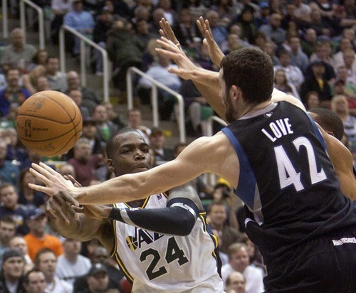 Jeremy Harmon     The Salt Lake Tribune  Paul Millsap passes the ball around Minnesota's Kevin Love and Wes Johnson as the Jazz host the Timberwolves at EnergySolutions Arena Saturday, Jan. 21, 2012 in Salt Lake City.
