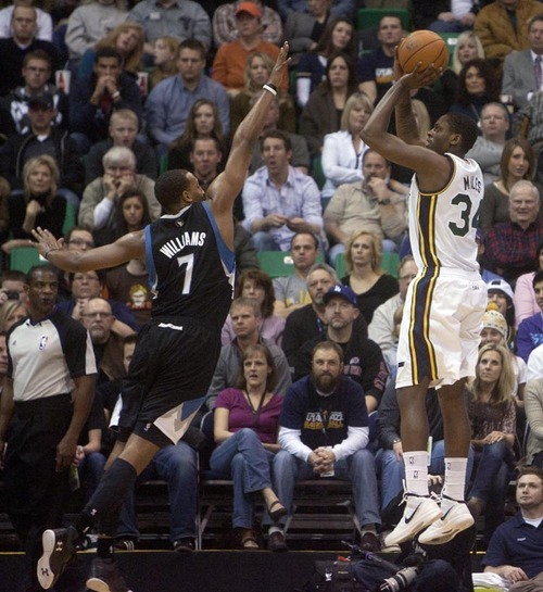 Jeremy Harmon     The Salt Lake Tribune  C.J. Miles gets a basket under pressure from Minnesota's Derrick Williams as the Jazz host the Timberwolves at EnergySolutions Arena Saturday, Jan. 21, 2012 in Salt Lake City.