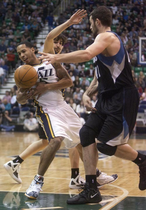 Jeremy Harmon     The Salt Lake Tribune  Devin Harris tries to move past Minnesota's Ricky Rubio and Kevin Love as the Jazz host the Timberwolves at EnergySolutions Arena Saturday, Jan. 21, 2012 in Salt Lake City.