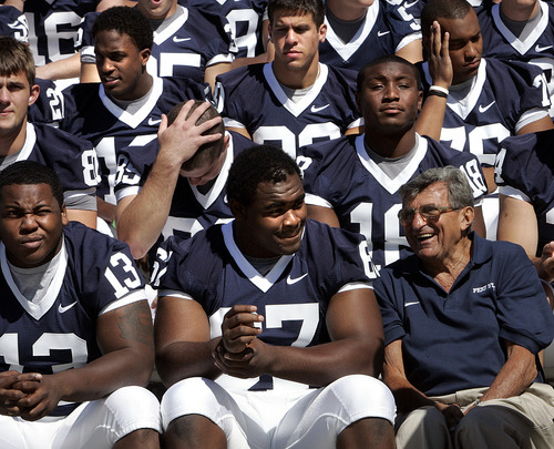 ** FILE ** Penn State head coach Joe Paterno, bottom right, sits next to senior tackle and team co-captian Levi Brown, bottom center,  for the team photo during media day at Beaver Stadium in State College, Pa., in this Saturday, Aug. 12, 2006, file photo. Paterno is entering his 41st season leading the Nittany Lions.  (AP Photo/Carolyn Kaster)