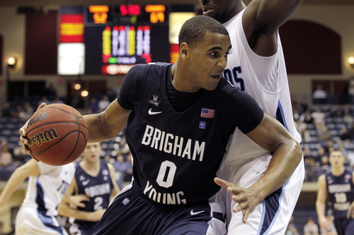 Brigham Young's Brandon Davies (0) drives towards the basket against San Diego in the second half during an NCAA college basketball game  Monday, Jan. 16, 2012, in San Diego. (AP Photo/Gregory Bull)
