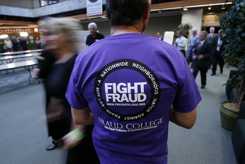 File photo Francisco Kjolseth  |  The Salt Lake Tribune Rex Ashdown, a former FBI agent and member of the FBI Citizens' Academy, helped out with Fraud College in 2010. This year's event is Feb. 15 at the University of Utah.