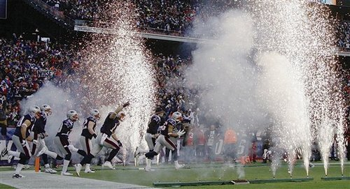 The New England Patriots run onto the field to start the AFC Championship NFL football game against the Baltimore Ravens Sunday, Jan. 22, 2012, in Foxborough, Mass.  (AP Photo/Elise Amendola)