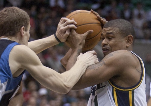 Jeremy Harmon  |  The Salt Lake Tribune  Earl Watson is fouled by Luke Ridnour as the Jazz host the Timberwolves at EnergySolutions Arena Saturday, Jan. 21, 2012 in Salt Lake City.