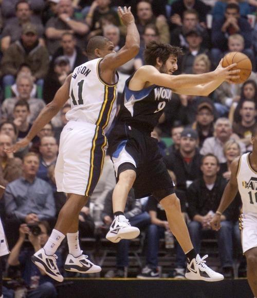 Jeremy Harmon  |  The Salt Lake Tribune  earl watson defends Minnesota's Ricky Rubio as the Jazz host the Timberwolves at EnergySolutions Arena Saturday, Jan. 21, 2012 in Salt Lake City.