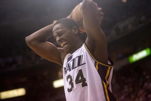 Jeremy Harmon  |  The Salt Lake Tribune  C.J. Miles reacts to knocking the ball out of bounds as the Jazz host the Timberwolves at EnergySolutions Arena Saturday, Jan. 21, 2012 in Salt Lake City.