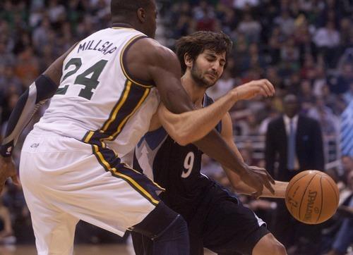 Jeremy Harmon  |  The Salt Lake Tribune  Paul Millsap fouls Minnesota's Ricky Rubio as the Jazz host the Timberwolves at EnergySolutions Arena Saturday, Jan. 21, 2012 in Salt Lake City.