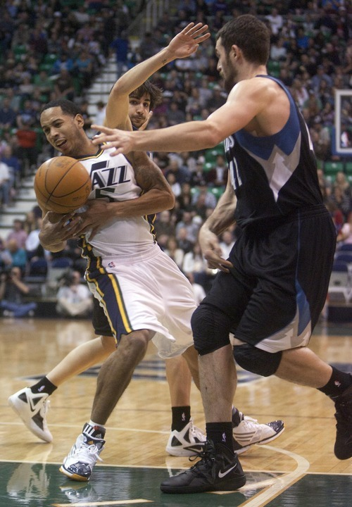 Jeremy Harmon  |  The Salt Lake Tribune  Devin Harris tries to move past Minnesota's Ricky Rubio and Kevin Love as the Jazz host the Timberwolves at EnergySolutions Arena Saturday, Jan. 21, 2012 in Salt Lake City.