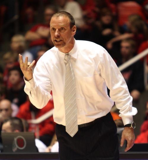 Rick Egan  | The Salt Lake Tribune   Utah head coach Larry Krystkowiak shouts directions to his players in a game against Washington at the Huntsman Center, Saturday, Jan. 7, 2012.