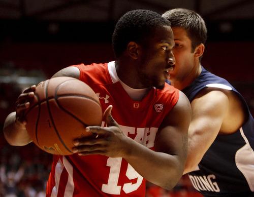 Trent Nelson  |  The Salt Lake Tribune Utah's Josh Watkins, defended by BYU's Craig Cusick as Utah hosted BYU at the Huntsman Center, college basketball in Salt Lake City, Utah, Saturday, December 10, 2011.