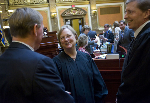 Al Hartmann  |  The Salt Lake Tribune Utah Supreme Court Chief Justice Christine Durham, center, gets ready to give the State of the Judiciary address to members of the House of Representatives on Monday, Jan. 23.  She announced she would be stepping down as chief justice.  Justice Matthew Durrant, right, will replace her as chief justice.