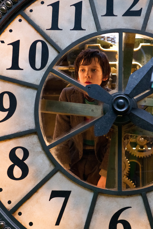 In this image released by Paramount Pictures, Asa Butterfield portrays Hugo Cabret in a scene from