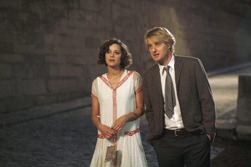 Gil (Owen Wilson, right) makes time with Adriana (Marion Cotillard), a woman from the 1920s, in Woody Allen's comedy
