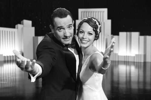 Jean Dujardin portrays George Valentin, left, and Berenice Bejo portrays Peppy Miller in a scene from