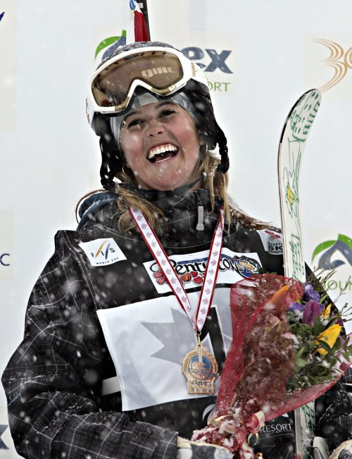 In this March 17, 2006, file photo, Sarah Burke of Canada, smiles as she celebrates her gold medal in the halfpipe FIS world Cup event Friday, March 17, 2006 at Apex Mountain in Penticton, British Columbia.  Burke died Thursday, Jan. 19, 2012,  nine days after crashing at the bottom of the superpipe during a training run in Utah. She was 29. Burke was injured Jan. 11 while training at a personal sponsor event at the Park City Mountain resort. (AP Photo/The Canadian Press,  Jacques Boissinot)