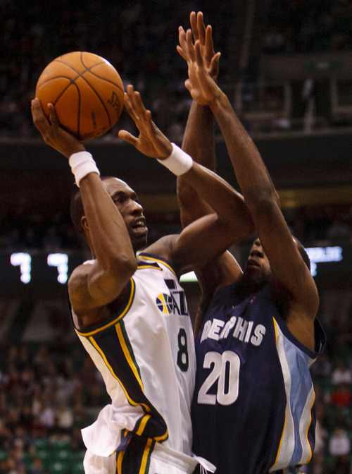 Trent Nelson  |  The Salt Lake Tribune Utah Jazz forward/guard Josh Howard (8) shoots the ball with Memphis Grizzlies forward Quincy Pondexter (20) defending as the Utah Jazz face the Memphis Grizzlies, NBA basketball at EnergySolutions Arena in Salt Lake City, Utah, Friday, January 6, 2012.