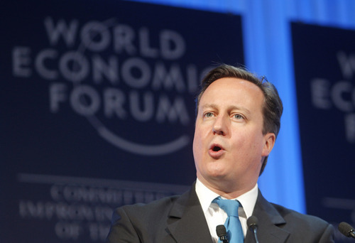 British Prime Minister David Cameron, speaks during a session at the World Economic Forum in Davos, Switzerland, Thursday, Jan. 26, 2012.  British Prime Minister David Cameron backed the idea of a free trade deal between the European Union and the U.S. on Thursday, suggesting that a trans-Atlantic pact could deliver a much-needed boost to global commerce. (AP Photo/Michel Euler)