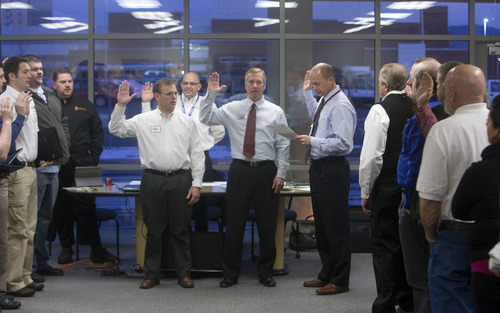Al Hartmann  |  The Salt Lake Tribune Two new members of Utah's Business Networking International raise their right hand to be sworn into the organization during a weekly morning meeting.  Each member of the group is focued to give solid referrals to others within the group during their weekly morning meetings.    Members who don't perform well, who don't attend meetings or who pass bad referrals get the boot. They mean business