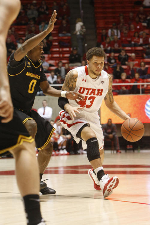 Chris Detrick  |  The Salt Lake Tribune Utah Utes guard Cedric Martin (43) is guarded by Arizona State Sun Devils guard/forward Carrick Felix (0) during the first half of the game at the Huntsman Center Saturday January 21, 2012. Utah is winning the game 38-21.
