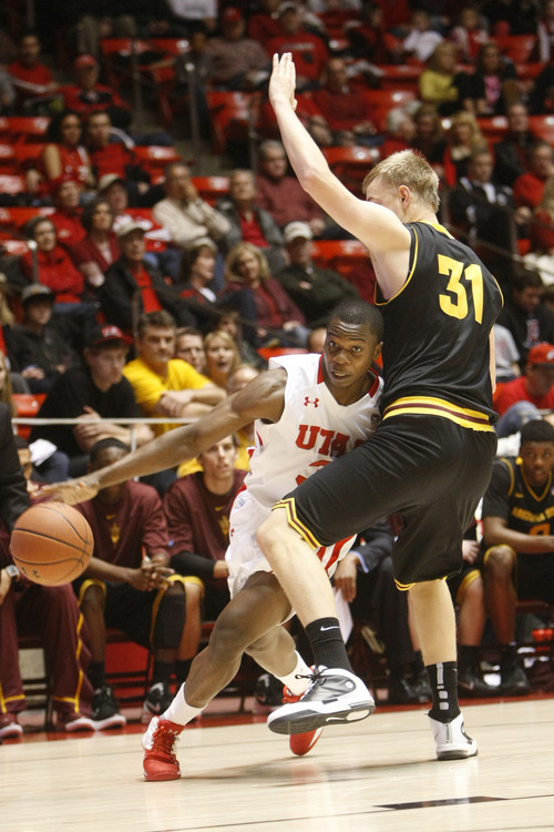 Chris Detrick  |  The Salt Lake Tribune Utah Utes guard Anthony Odunsi (3) is guarded by Arizona State Sun Devils forward Jonathan Gilling (31) during the first half of the game at the Huntsman Center Saturday January 21, 2012. Utah is winning the game 38-21.