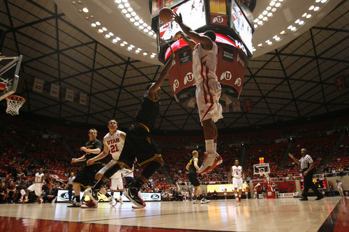Chris Detrick  |  The Salt Lake Tribune Utah Utes guard Chris Hines (0) shoots a three-pointer past Arizona State Sun Devils forward Kyle Cain (5) during the first half of the game at the Huntsman Center Saturday January 21, 2012. Utah is winning the game 38-21.