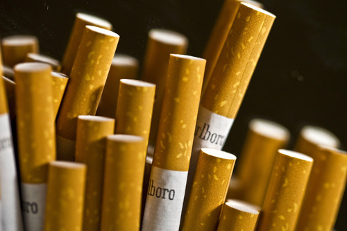 Chris Goodney  |  Bloomberg A judge on Monday blocked a federal requirement that would have begun forcing tobacco companies next year to put graphic images, including dead and diseased smokers, on their cigarette packages.