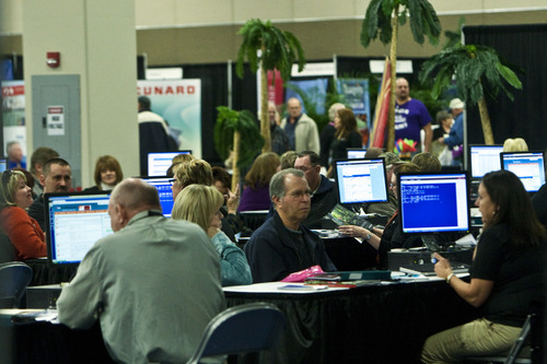 Chris Detrick     The Salt Lake Tribune Participants look around at travel exhibits during the Morris Murdock Travel Expo at the South Towne Expo Center Friday January 27, 2012. Morris Murdock Travel Expo is the largest in state, with over 100 vendors.