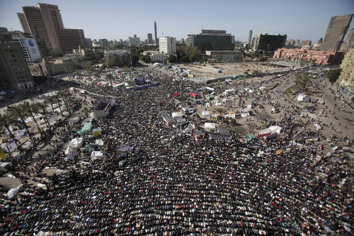 Egyptian protestors attend Friday prayers during a rally to mark the first anniversary of