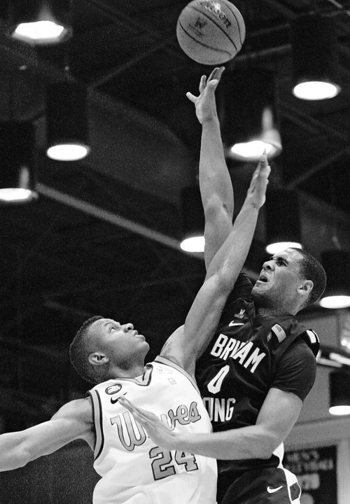 BYU's Brandon Davies (0) shoots against Pepperdine's Ramon Eaton (24) during the second half of an NCAA college basketball game, Saturday, Jan. 21, 2012, in Moraga, Calif. BYU won 77-64. (AP Photo/Ringo H.W. Chiu)